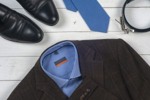 Picture of mans suit with shoes, tie, belt, shirt and blazer